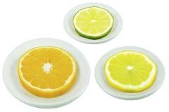 Kalk, Orange und Zitrone auf einer Untertasse Stockfotos