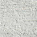 Kalkad gammal ojämn gropig grov lantlig bakgrund för tegelstenvägg Royaltyfria Foton
