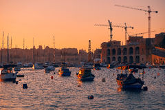 Kalkara bay in the sunset light, Malta. The view of Kalkara bay between Birgu and Kalkara peninsular in the sunset light, Malta Royalty Free Stock Images