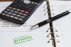 Kalkulator agendy ekonomii Zatwierdzony pojęcie Zdjęcie Royalty Free