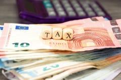 Kalkulator, euro pieniądze i podatek, fotografia royalty free