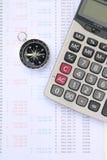 Kalkulator i kompas na banka oświadczeniu Zdjęcia Stock