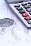 Kalkulator i kompas na banka oświadczeniu Fotografia Royalty Free