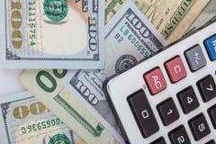 Kalkulator na dolarowym tle Obrazy Stock