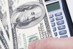 kalkulator palec pieniądze obrazy royalty free