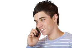 kalla stiligt lyckligt gör den male tonåringtelefonen Arkivfoto