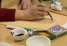 Kalligrafiövning royaltyfria bilder