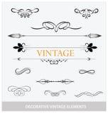 Kalligrafische wijnoogst elemets en geplaatste symbolen Stock Foto's