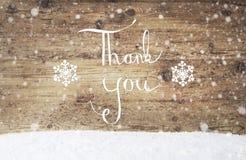 Kalligraphie danken Ihnen, hölzernem Hintergrund, Schnee, Schneeflocken Stockbild