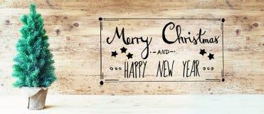 Kalligraphie, frohe Weihnachten und guten Rutsch ins Neue Jahr, Weihnachtsbaum Lizenzfreies Stockbild