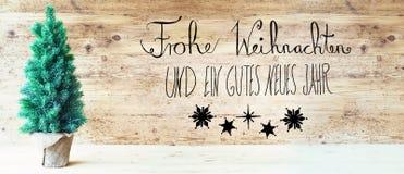 Kalligraphie, Gutes Neues bedeutet guten Rutsch ins Neue Jahr, Weihnachtsbaum Stockfoto