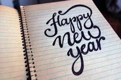 Kalligraphischer Hintergrund des guten Rutsch ins Neue Jahr Stockfotografie
