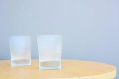 Kallt exponeringsglas på tabellen Arkivfoto