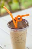 Kallt kaffe med is- och apelsinkulor Arkivfoto
