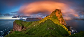 Kallur Lighthouse Panorama. Panorama of Kalsoy island and Kallur lighthouse in sunset light, Faroe Islands royalty free stock image