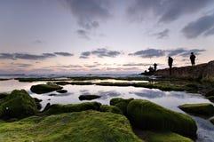 Kalm landschap met vissers Stock Afbeeldingen