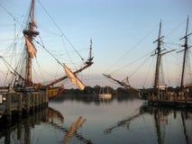 Kalmar Nyckel and Sultana. Tall ships Kalmar Nyckel and Sultana docked at Cape Charles, with a small sailboat in the background Stock Photo