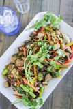 Kalo Stir-Fry. Hawaiian stir-fry made with taro, kale, broccoli, carrot, onion, bell pepper and fern shoots Royalty Free Stock Images