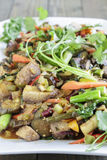 Kalo Stir-Fry. Hawaiian stir-fry made with taro, kale, broccoli, carrot, onion, bell pepper and fern shoots Royalty Free Stock Image