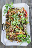 Kalo Stir-Fry. Hawaiian stir-fry made with taro, kale, broccoli, carrot, onion, bell pepper and fern shoots Stock Image