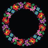 Kalocsai embroidery in circle - Hungarian floral folk pattern on black Stock Image