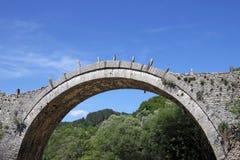Kalogeriko arched stone bridge Zagoria. Greece Stock Images