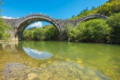 Kalogeriko bridge. Zagoria, Greece. Arches stone bridge of Kalogeriko or Plakida on the river of Voidomatis. Central Zagoria, Epirus, Greece Stock Photo
