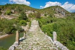 Kalogeriko stone bridge. Zagoria, Greece. Three arches stone bridge of Kalogeriko or Plakida on the river of Voidomatis. Central Zagoria, Epirus, Greece Stock Photo