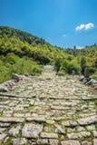Kalogeriko stone bridge. Zagoria, Greece. Three arches stone bridge of Kalogeriko or Plakida on the river of Voidomatis. Central Zagoria, Epirus, Greece Royalty Free Stock Photos