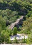 Kalogeriko triple arched stone bridge, Epirus, Greece. Kalogeriko (or Plakidas) stone bridge is a three-arch stone bridge on the river of Voidomatis, tributary Stock Photo