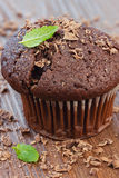 Kalorienbombe. Chocolate muffin on wooden board Royalty Free Stock Photo