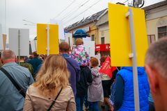 Kaluga city, Russia - May 2019: little girl wearing forage-cap seats on shoulders of her father and participates in parade. Kaluga city russia may 2019 little royalty free stock photography