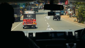 KALUTHARA, SRI LANKA - 25.09.2016: Streets of Sri Lanka from a minibus. View of Sri Lanka's streets from the window in the minibus stock video