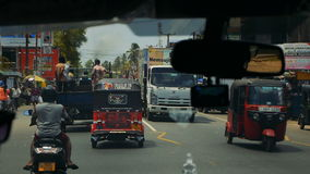 KALUTHARA, SRI LANKA - 25.09.2016: Streets Tuk Tuk on Sri Lanka street. View of Sri Lanka's streets from the window in the minibus stock video footage