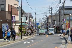 Kamakura city, Kamakura, Japan. Kamakura, Japan - May 18, 2017: Tourists and local people are walking along local street from Great Buddha of Kamakura to Hase stock photos