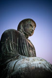 Great Buddha of Kamakura. Atmospheric shot with purple/blue sky of the 'Great Buddha of Kamakura' at the Kōtoku-in buddhist temple in Kamakra, Japan Royalty Free Stock Image