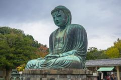 Tourists at statue of The Great Buddha of Kamakura, Japan. Kamakura, Japan - November 10, 2016: Tourists at statue of The Great Buddha of Kamakura, Japan Stock Photography