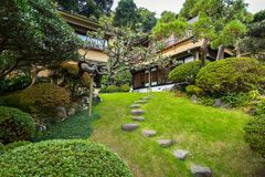 Traditional architecture with oriental garden in Kamakura, Japan. Kamakura, Japan - November 10, 2016: Traditional architecture with oriental garden in Kamakura Stock Photo