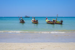 Kamala beach. Long-tail boats on long Kamala beach, Thailand Stock Image