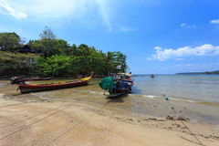 Kamala Beach. Phuket, Thailand - 28 March, 2015: Unidentified fisherman boats at Kamala Beach, Phuket province Thailand Royalty Free Stock Photos