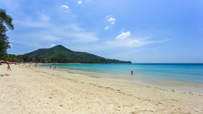 Kamala Beach. Phuket, Thailand - 28 March, 2015: Unidentified tourist enjoy on the beach and crystal clear water at Kamala Beach, Phuket province Thailand Stock Images