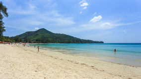 Kamala Beach. Phuket, Thailand - 28 March, 2015: Unidentified tourist enjoy on the beach and crystal clear water at Kamala Beach, Phuket province Thailand Royalty Free Stock Images