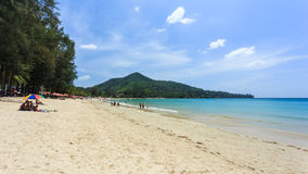 Kamala Beach. Phuket, Thailand - 28 March, 2015: Unidentified tourist enjoy on the beach and crystal clear water at Kamala Beach, Phuket province Thailand Royalty Free Stock Photos