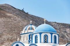 Kamari church and hill Stock Photography