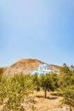 Kamari church from the olive grove Stock Image