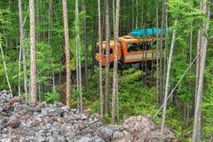 Kamaz in the taiga. Road to Klyuchevskoy Nature Park. Kamchatka Peninsula. Royalty Free Stock Image