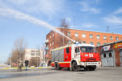 Kamaz truck, Russian fire engine with running hose Stock Images
