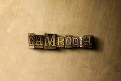 KAMBODSCHA - Nahaufnahme des grungy Weinlese gesetzten Wortes auf Metallhintergrund Stockfotos