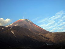Kamchatka peninsula, the landscape. Early morning and the blue sky, the volcano. Kamchatka, Russia Royalty Free Stock Photography