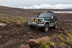 Off-road expedition auto Toyota Land Cruiser Prado driving on mountain road. KAMCHATKA PENINSULA, RUSSIA - SEP 17, 2016: Extreme off-road expedition auto Toyota royalty free stock images